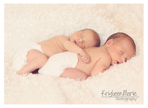 sleeping twin newborns