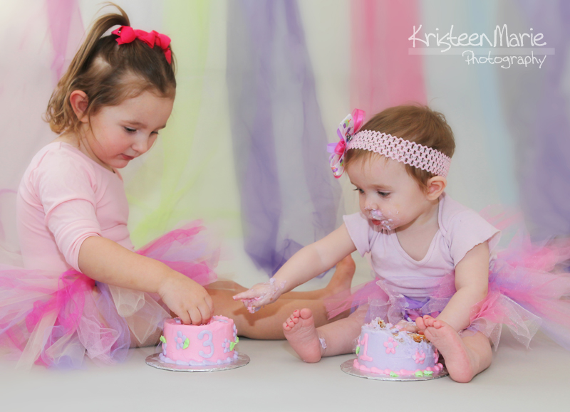 Sisters Smash Cake Together