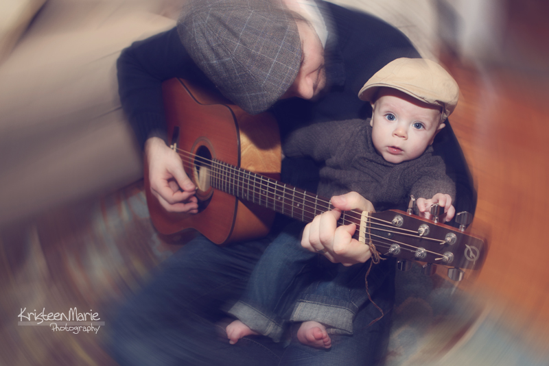 Dad Playing the Guitar wtih Baby