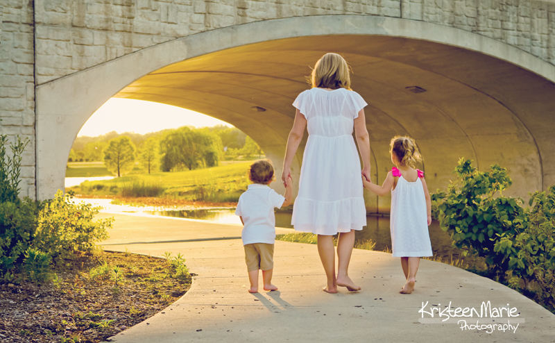 Mom with kids under the bridge