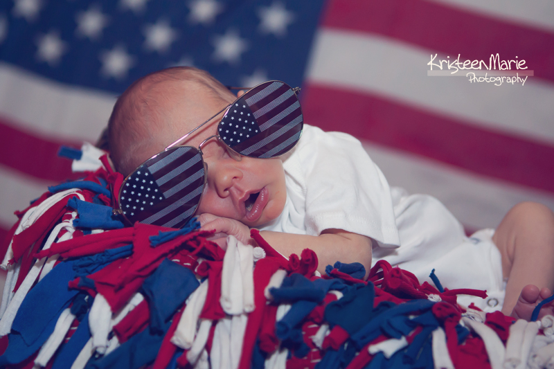 newborn in flag sunglasses