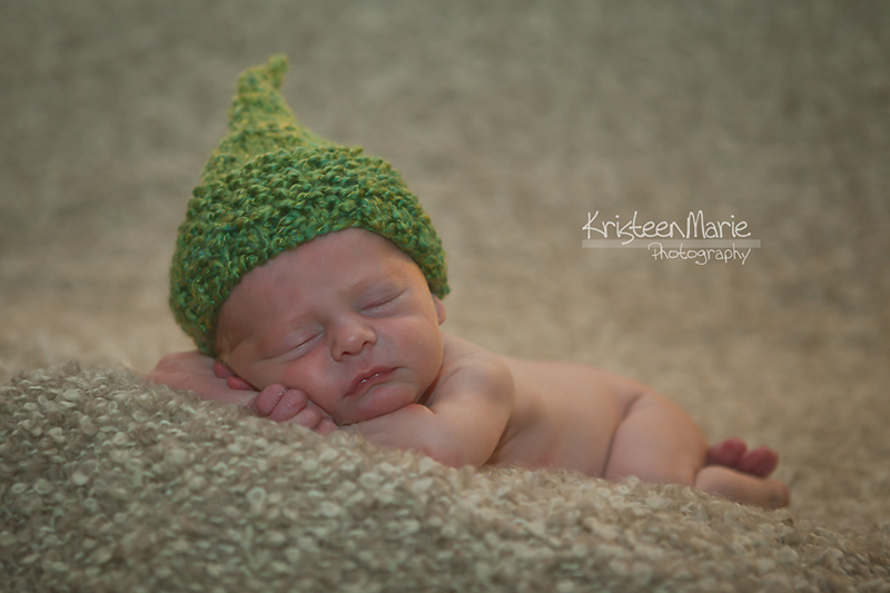 Sleeping Newborn with Green Hat