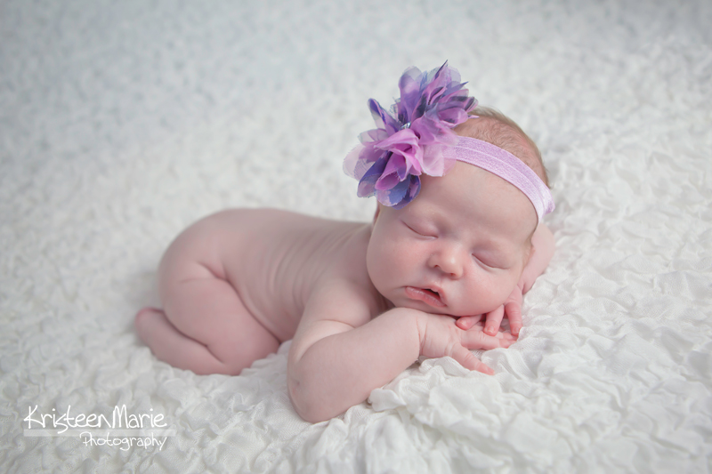 Newborn with purple headband