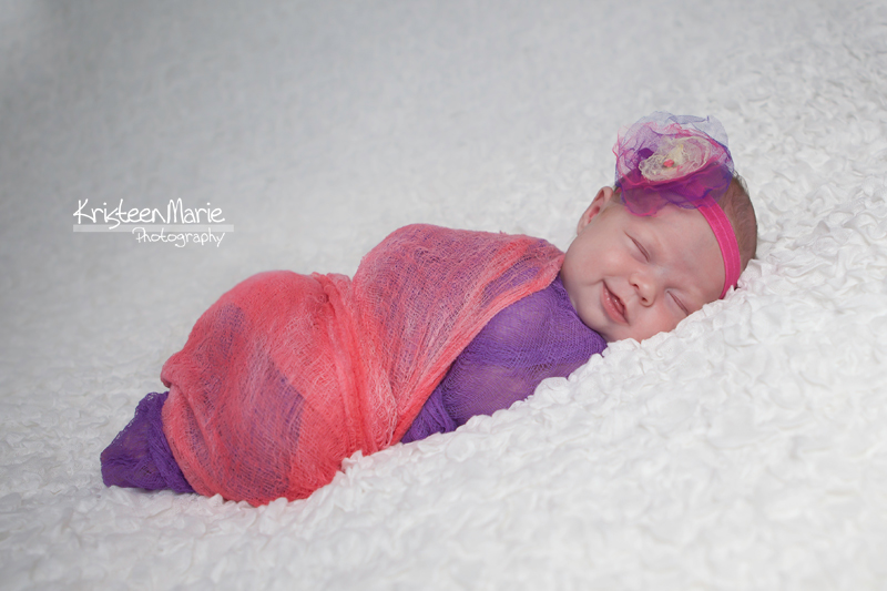 Smiling Baby in Pink and Purple