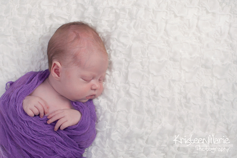 Newborn in Purple Wrap