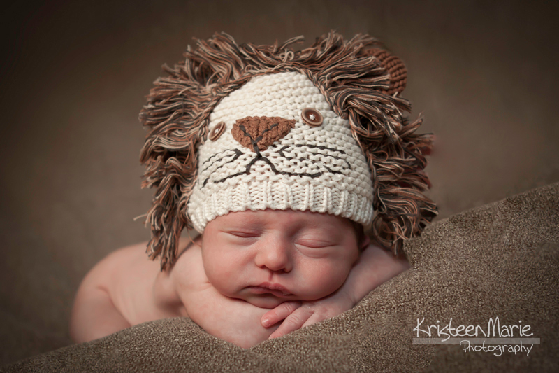 newborn with lion hat