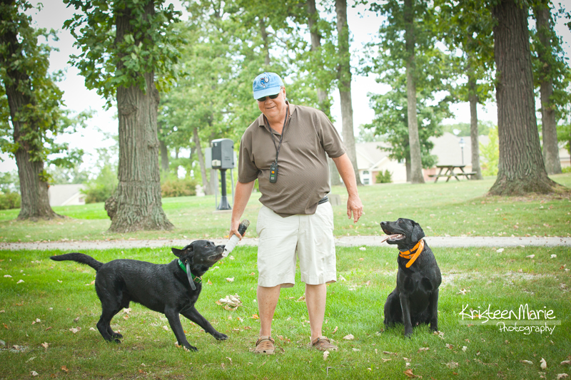Dad with two black labs