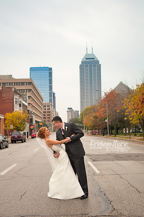 Bride and groom in street downtown Indianapolis