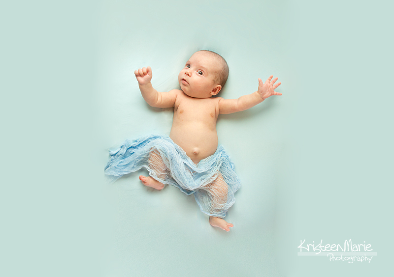 Baby boy on blue background