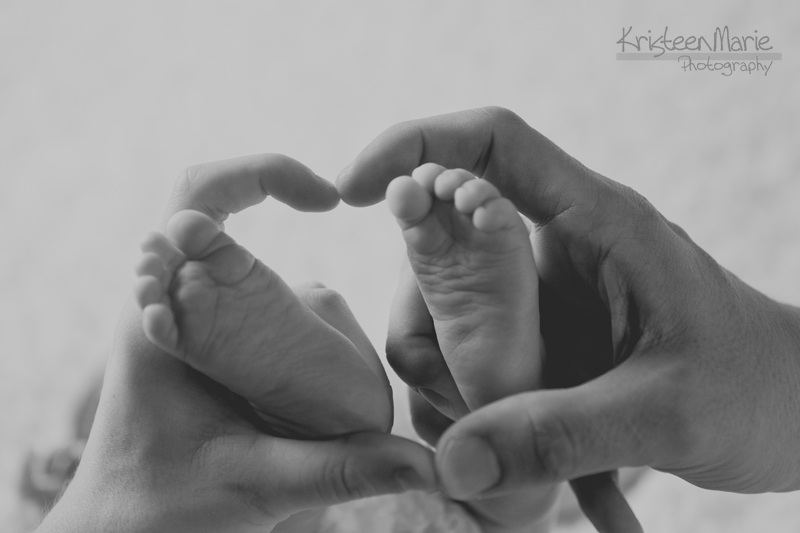 baby feet - heat in parent's hands