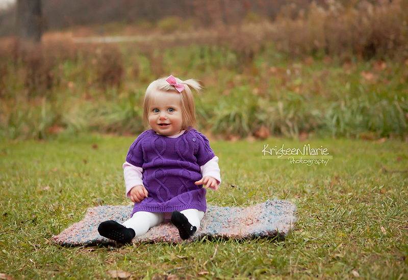 Baby in purple dress