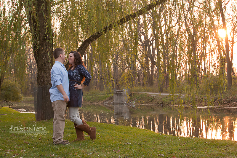 Couple in sunset with weeping willow tree