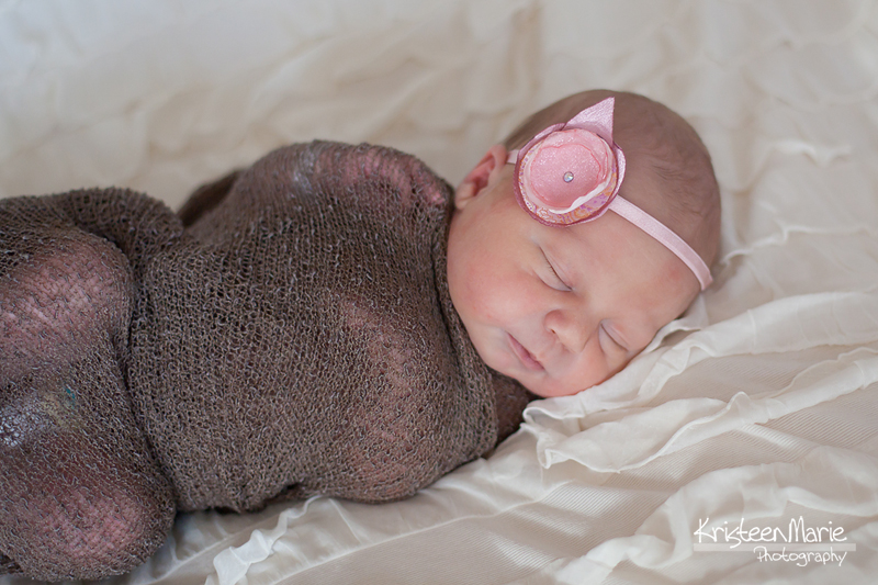 Baby girl in pink, tan, and brown