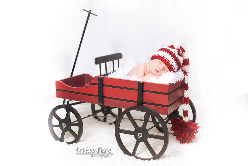 Newborn in Christmas Sleigh