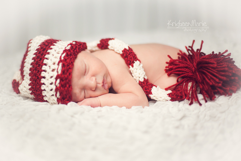 Newborn in red hat