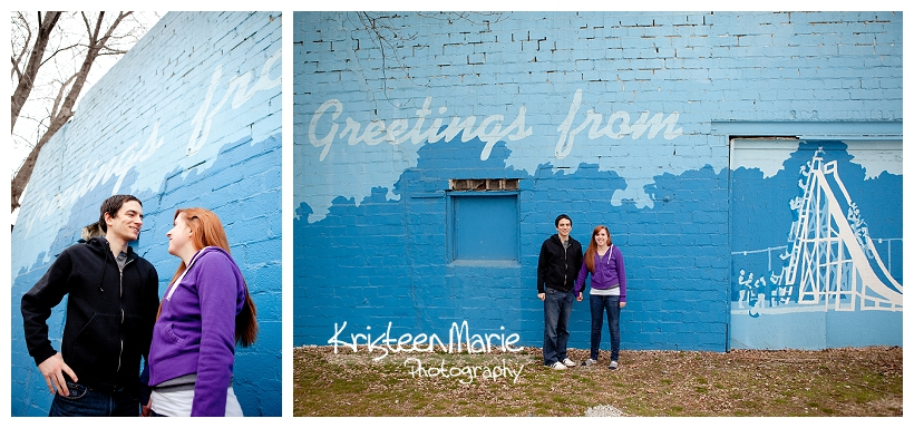 Couple against blue brick wall for engagemnet