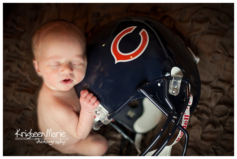 Newborn with Cubs helmet