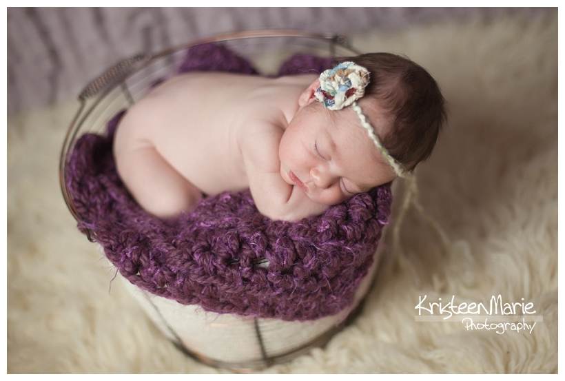 Baby in a basket and purple and cream