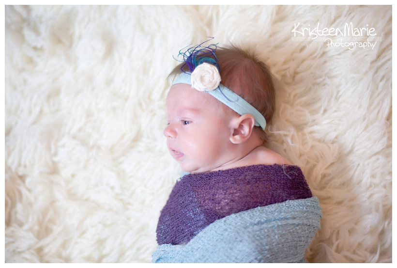 Baby in purple and teal