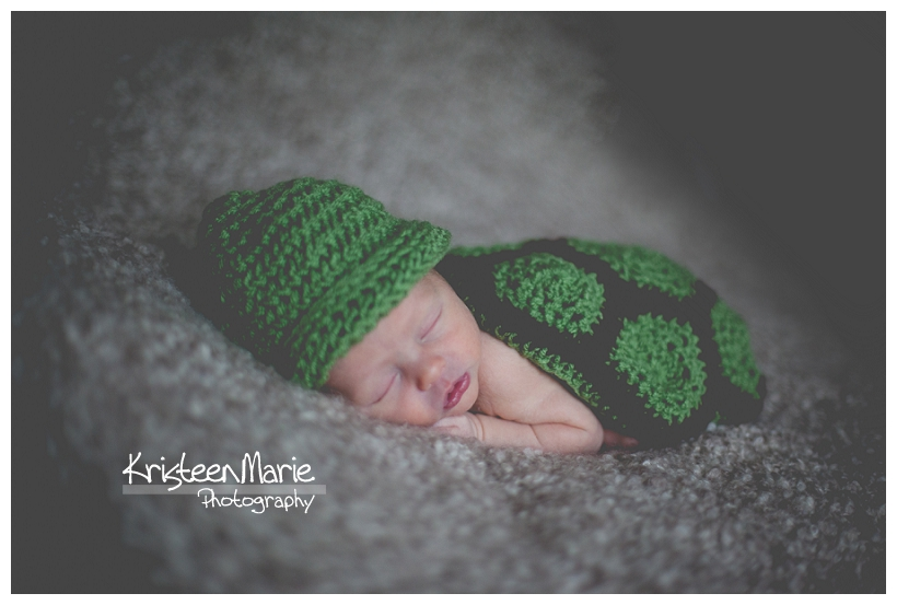 Newborn Baby in knit turtle outfit