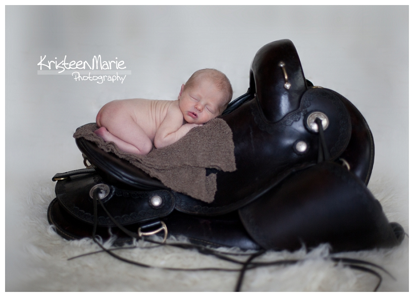 Newborn on saddle