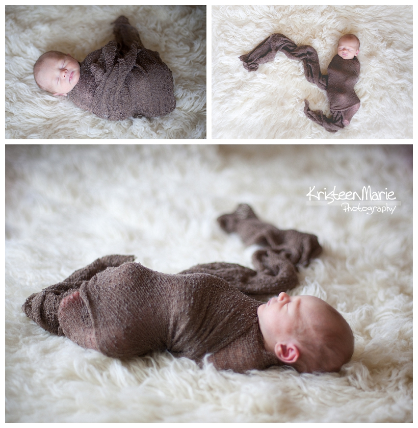 baby boy in brown wrap on shag rug