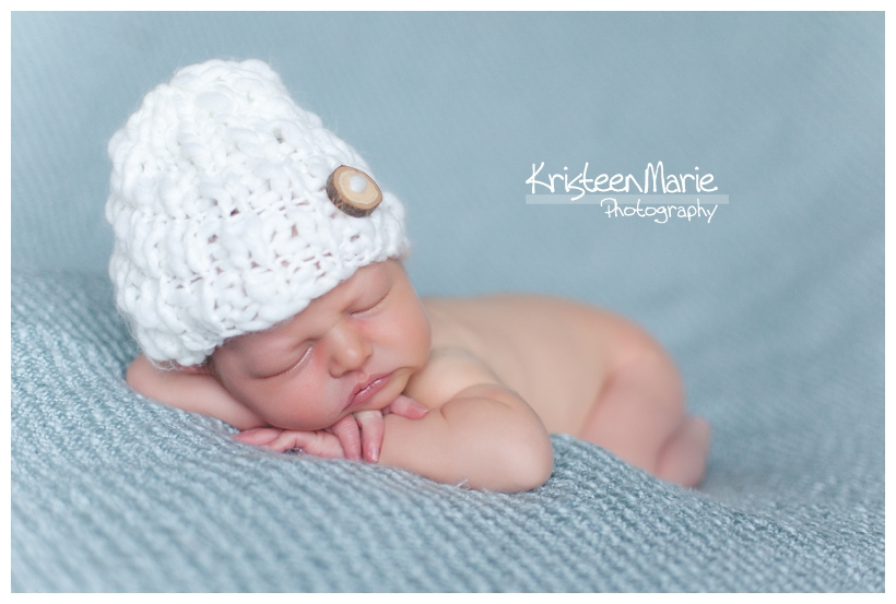 newborn boy in white knit hat