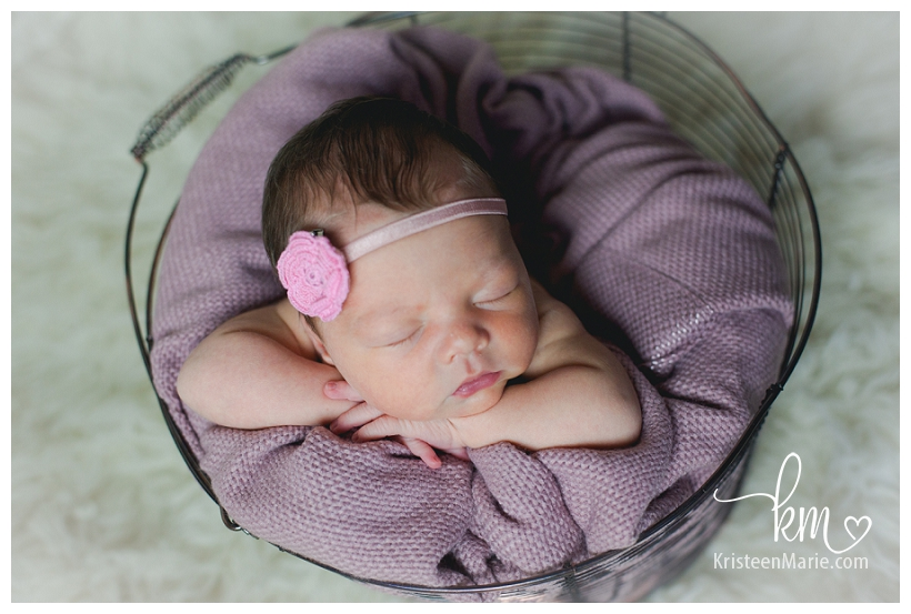newborn baby girl in a basket