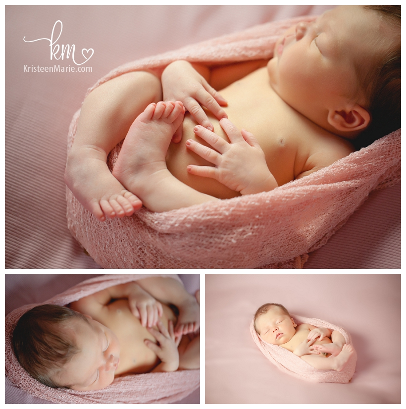 newborn baby girl in pink cocoon