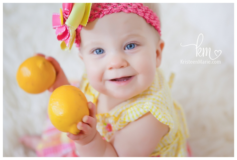 Baby Girl with Lemons