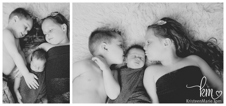 black and white sibling pictures with newborn baby