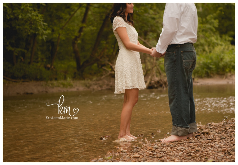 couple's feet in water