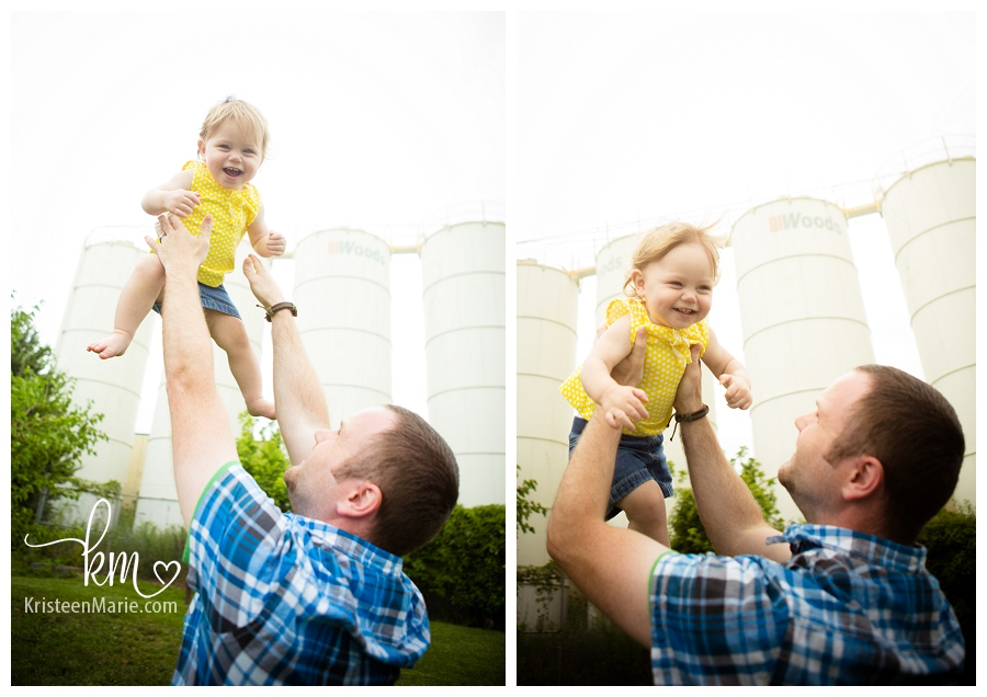 dad throwing baby girl