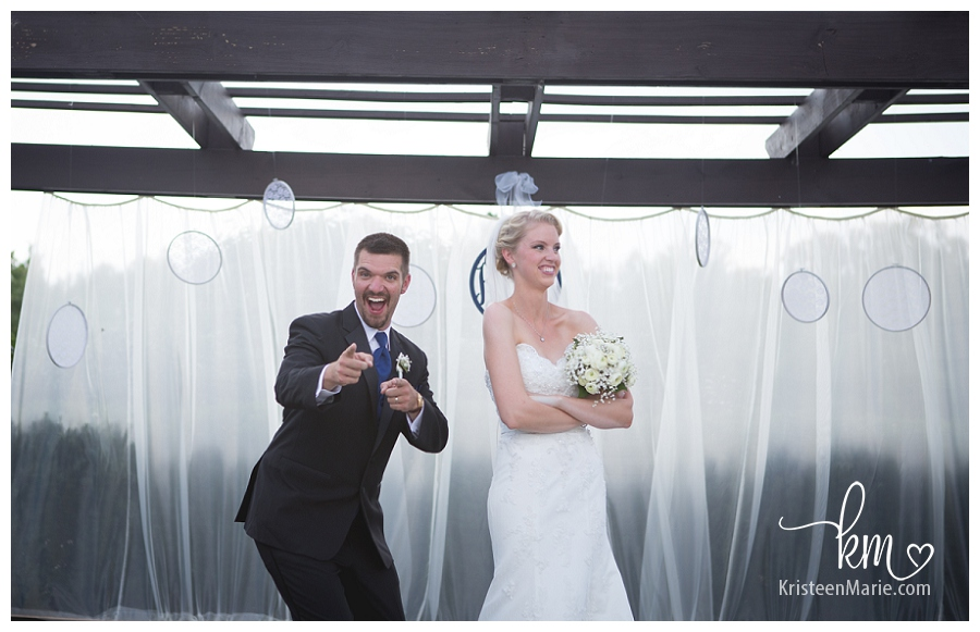 bride and groom being silly