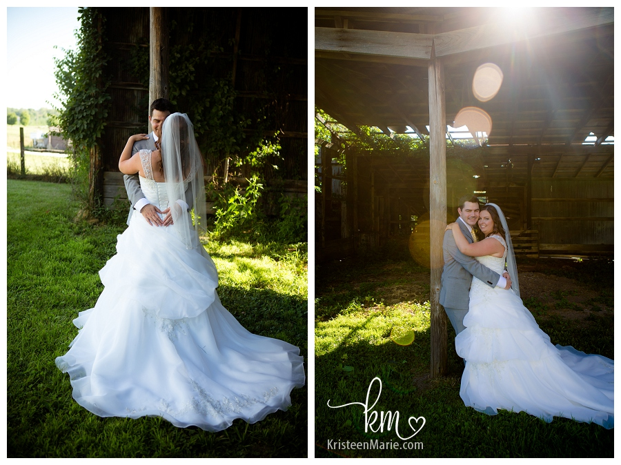 The bride and groom in barn