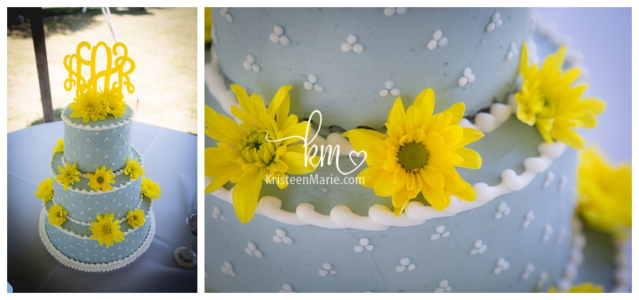blue and yellow wedding cake with yellow daisies
