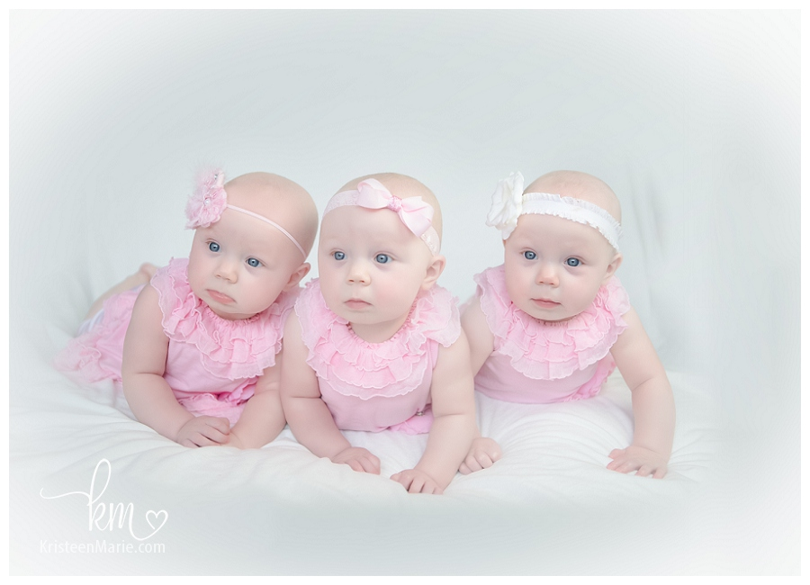 Triplet girls in pink