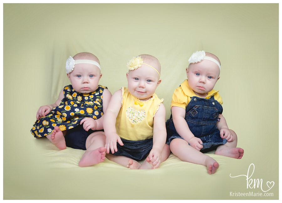 Triplet girls in yellow and blue