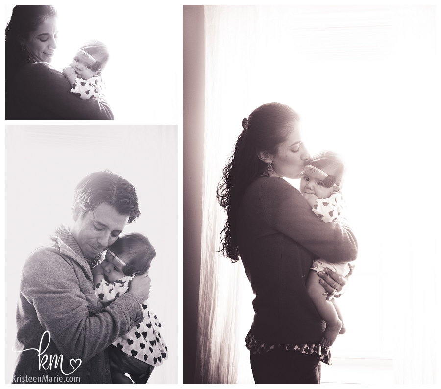 parents and baby in black and white