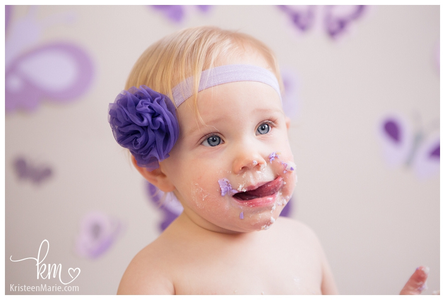 little girl with cake on her face