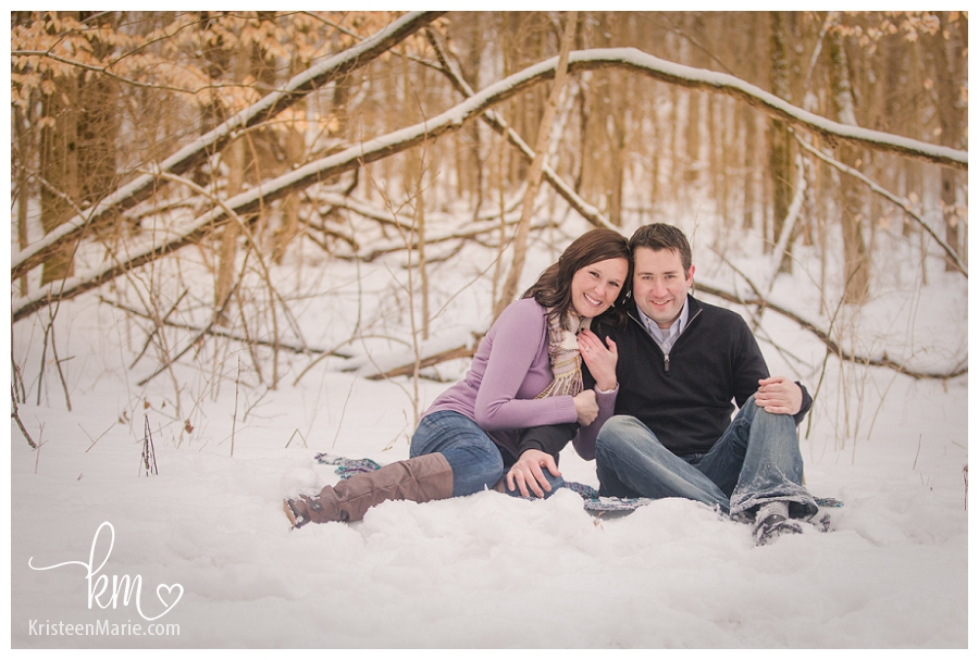 couple cuddled in snow
