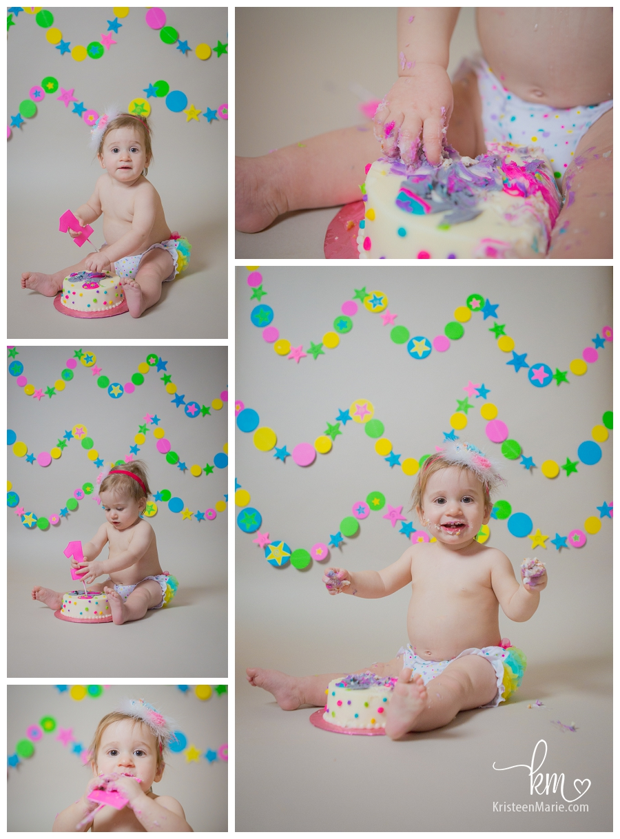 happy one year old eating cake