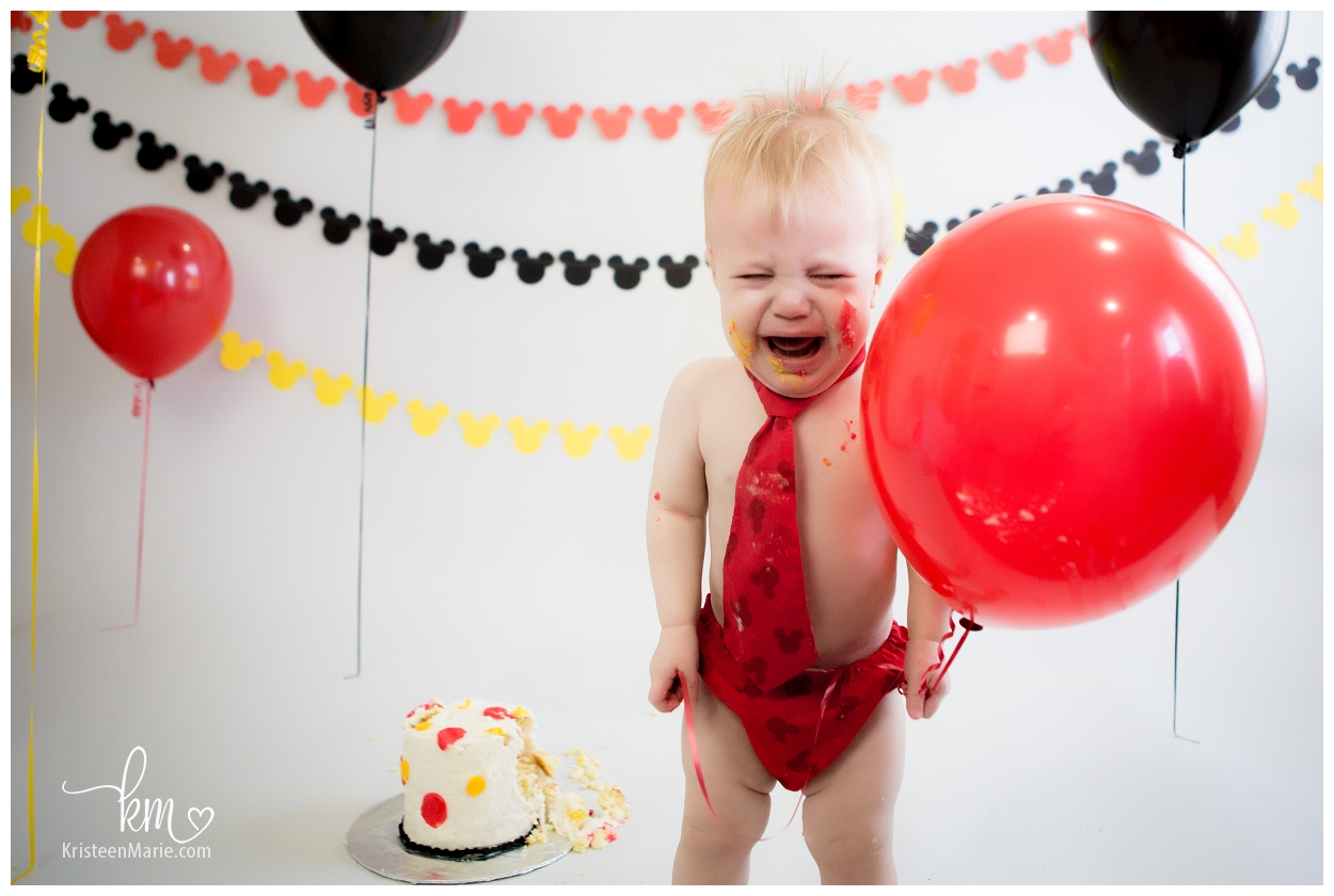 Unhappy Baby Smashing Cake with Balloon