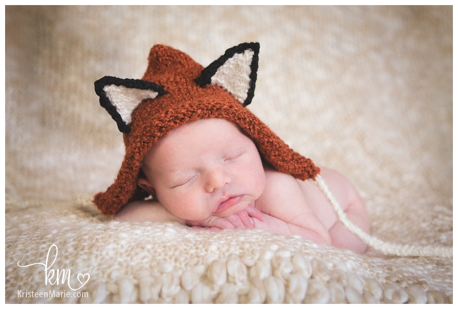 newborn in fox hat