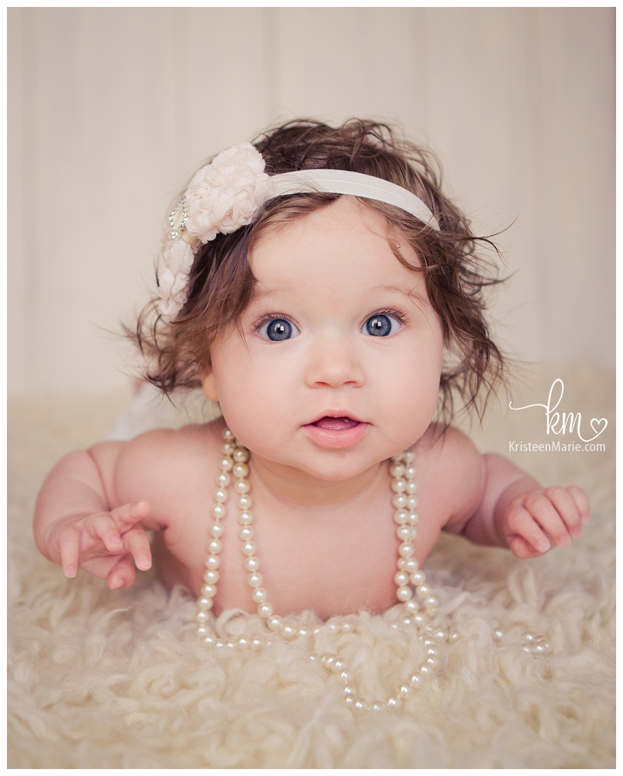 Child in pearls from Fishers Indiana