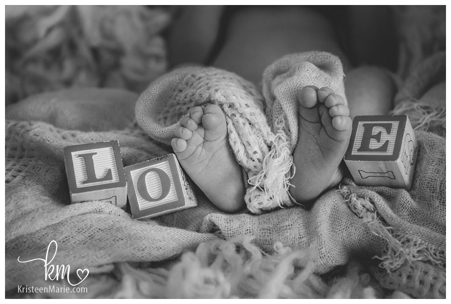 newborn photography with blocks and feet - LOVE