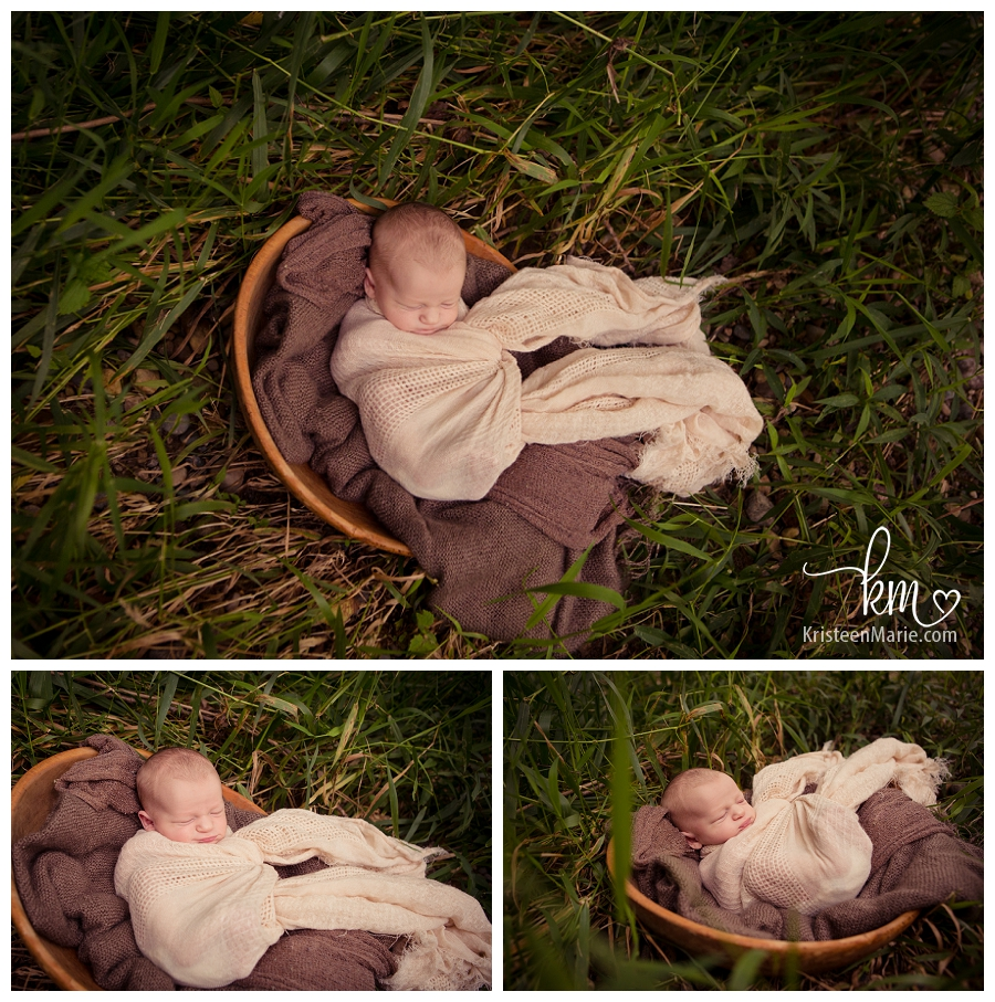baby sleeping in tall grass outside - Indianapolis newborn photography