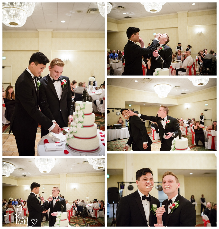 Gay couple cutting cake at wedding