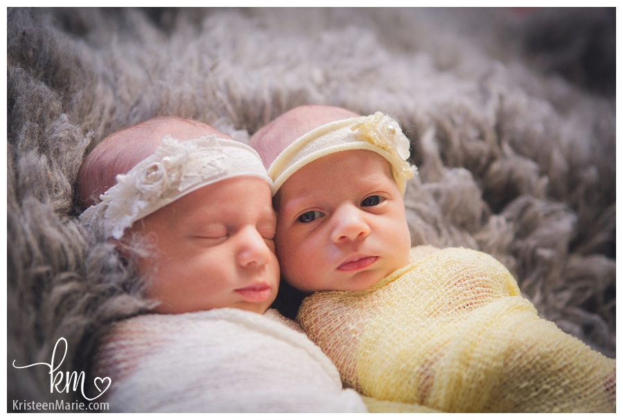 twin newborn girls with one girl awake