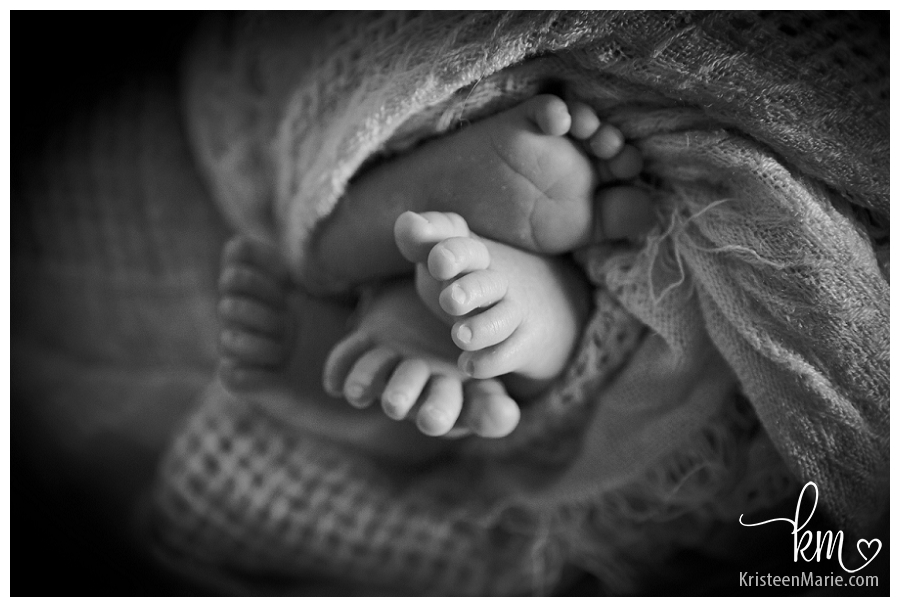 black and white twin newborn feet